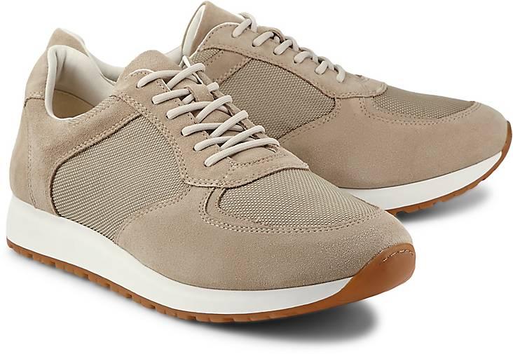 beigefarbene Puma Schuhe